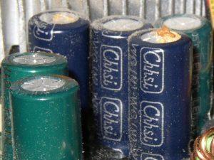 Example of capacitor bulge & leak.